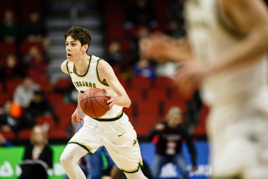 Iowa City West's Patrick McCaffery (22) dribbles up court during their boys 4A state basketball tournament game on Wednesday, March 6, 2019 in Des Moines. Dubuque, Senior would go on to defeat Iowa City, West 39-36.