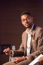 """Isaiah Oliver, president and CEO of the Community Foundation of Greater Flint, says he knew of Phil Hagerman before knowing him personally. """"He is a person who cares enough for community to invest personal resources to make it better."""" This photo was taken October 2016 in Aspen, during a panel discussion on philanthropy."""