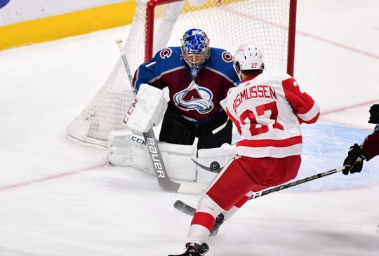 Detroit Red Wings center Michael Rasmussen (27) shoots on Colorado Avalanche goaltender Semyon Varlamov (1) in the second period at the Pepsi Center on Tuesday, March 5, 2019.