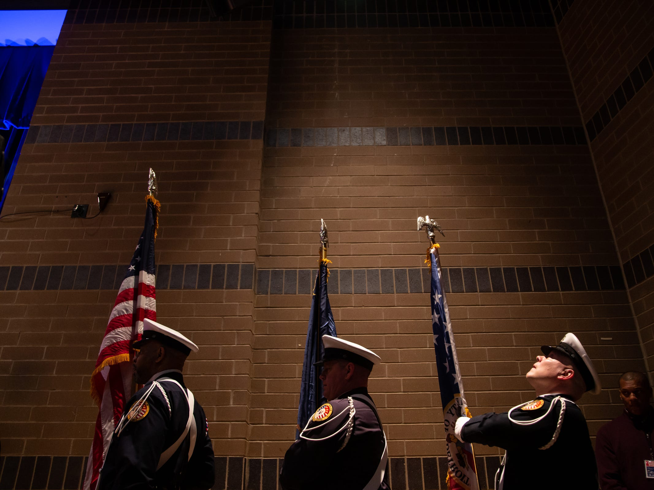 Detroit Police Color Guard members prepare to present the colors before Detroit Mayor Mike Duggan's speech during the 2019 State of the City Address on Tuesday, March 5, 2019 at East English Village Preparatory Academy in Detroit.