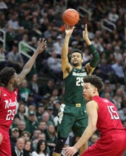 Michigan State forward Kenny Goins shoots against Nebraska's Nana Akenten and Isaiah Roby during first half action Tuesday, March 5, 2019 at the Breslin Center in East Lansing, Mich.