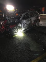 Police say a driver died after a vehicle crashed into the back of a semi-truck trailer along an interstate in northwestern Indiana and burst into flames.