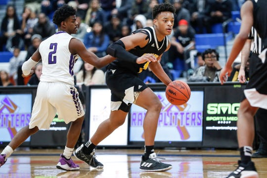 King's Chancey Willis Jr. (2) dribbles against Woodhaven's Josh Warren (2) during the second half of regional semifinal at Lincoln Park High School in Lincoln Park, Tuesday, March 5, 2019.