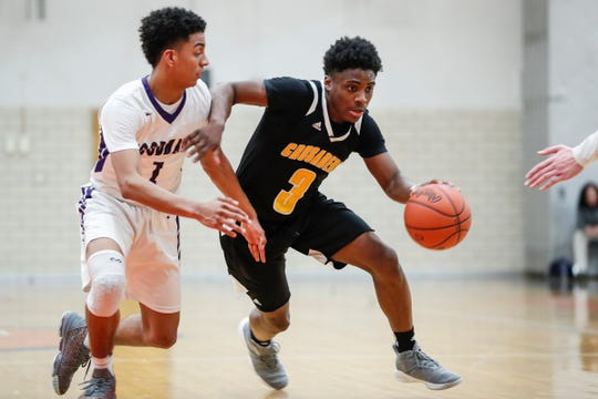King's Jordan Whitford (3) dribbles against Woodhaven's  Josh Warren (2) during the second half of regional semifinal at Lincoln Park High School in Lincoln Park, Tuesday, March 5, 2019.