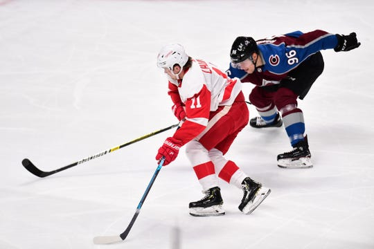 Detroit Red Wings right wing Filip Zadina (11) controls the puck away from Colorado Avalanche right wing Mikko Rantanen (96) in the second period at the Pepsi Center on Tuesday, March 5, 2019.