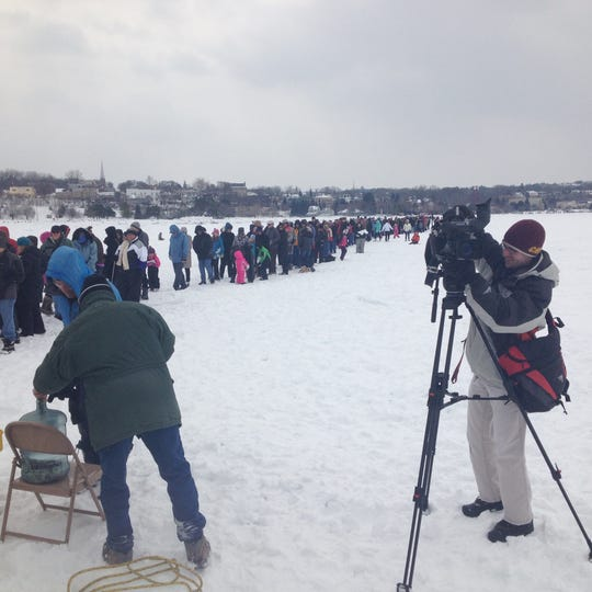 People lined up on the frozen Little Traverse Bay in 2015 to catch a glimpse of the underwater crucifix.