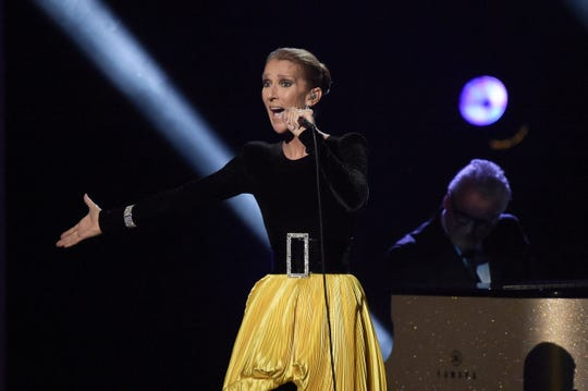 "This Jan. 13, 2019 file photo shows Celine Dion performing at the ""Aretha! A Grammy Celebration For The Queen Of Soul"" tribute in Los Angeles. The tribute will air on March 10, on CBS."