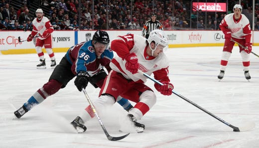 1146f63bbbd Colorado Avalanche right wing Mikko Rantanen (96) defends against Detroit  Red Wings right wing