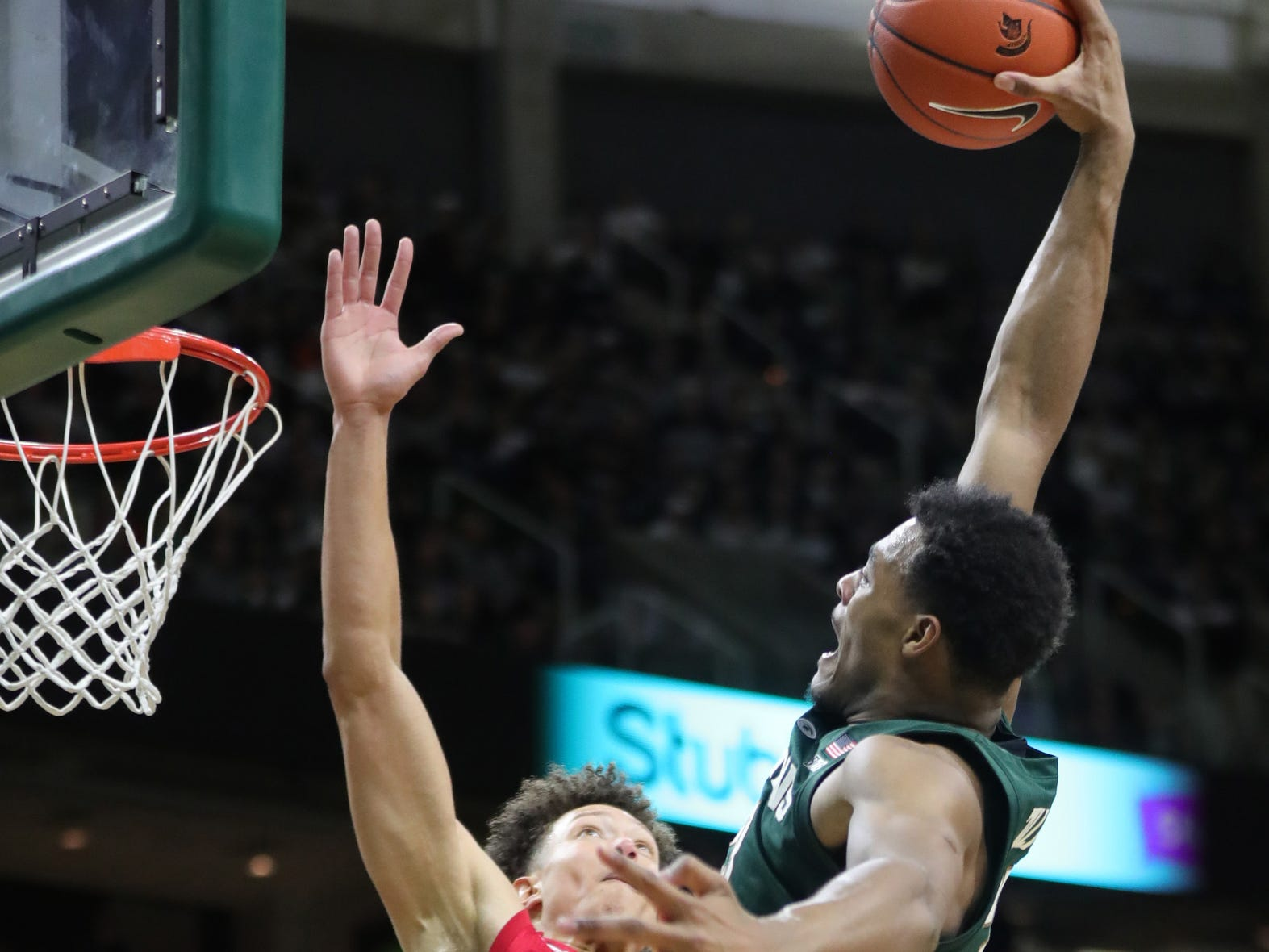 Michigan State forward Xavier Tillman shoots against Nebraska forward Isaiah Roby during first half action Tuesday, March 5, 2019 at the Breslin Center in East Lansing, Mich.