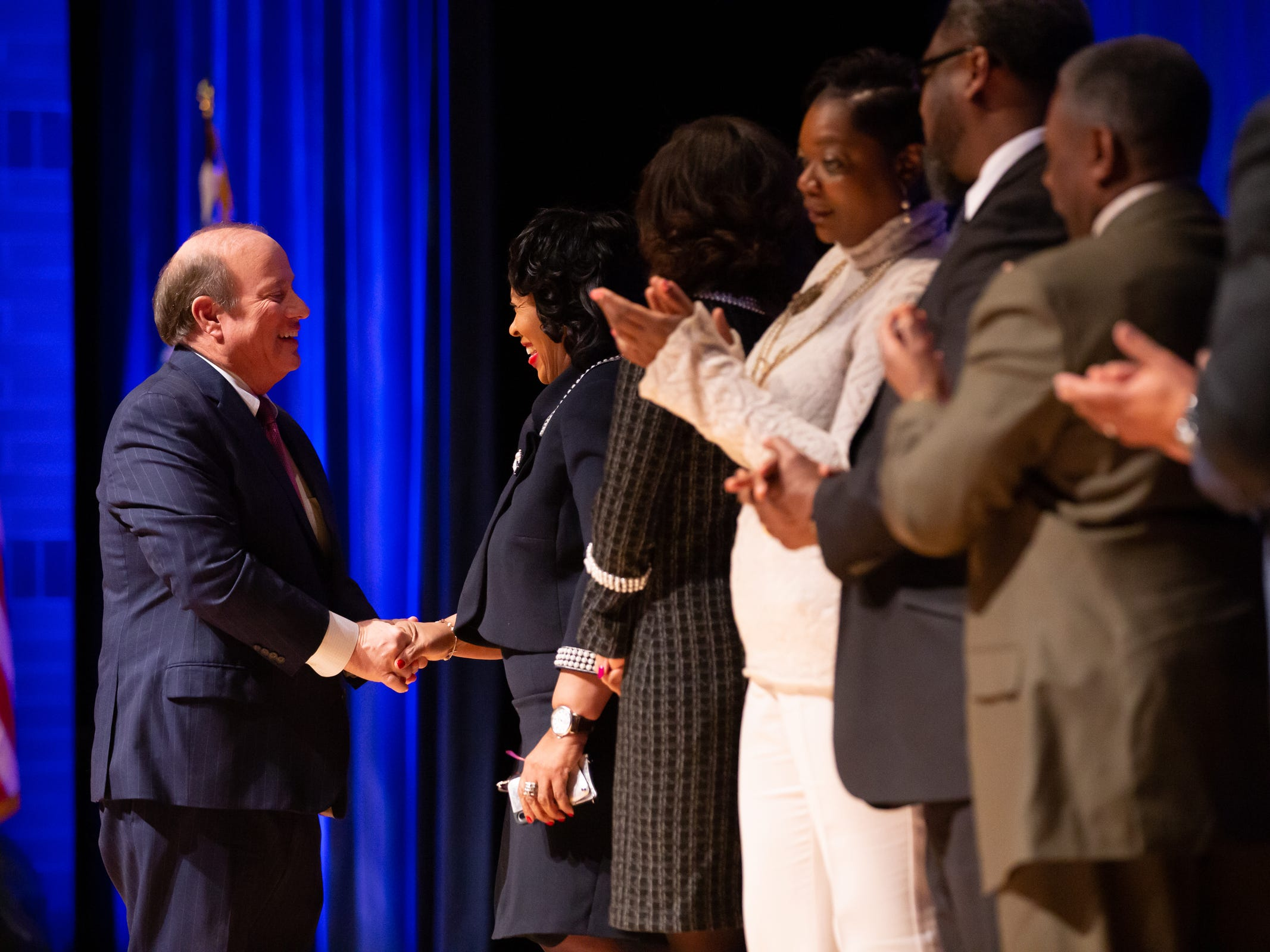 Detroit Mayor Mike Duggan shakes the hand of Detroit City Council President Brenda Jones before speaking during the 2019 State of the City Address on Tuesday, March 5, 2019 at East English Village Preparatory Academy in Detroit.
