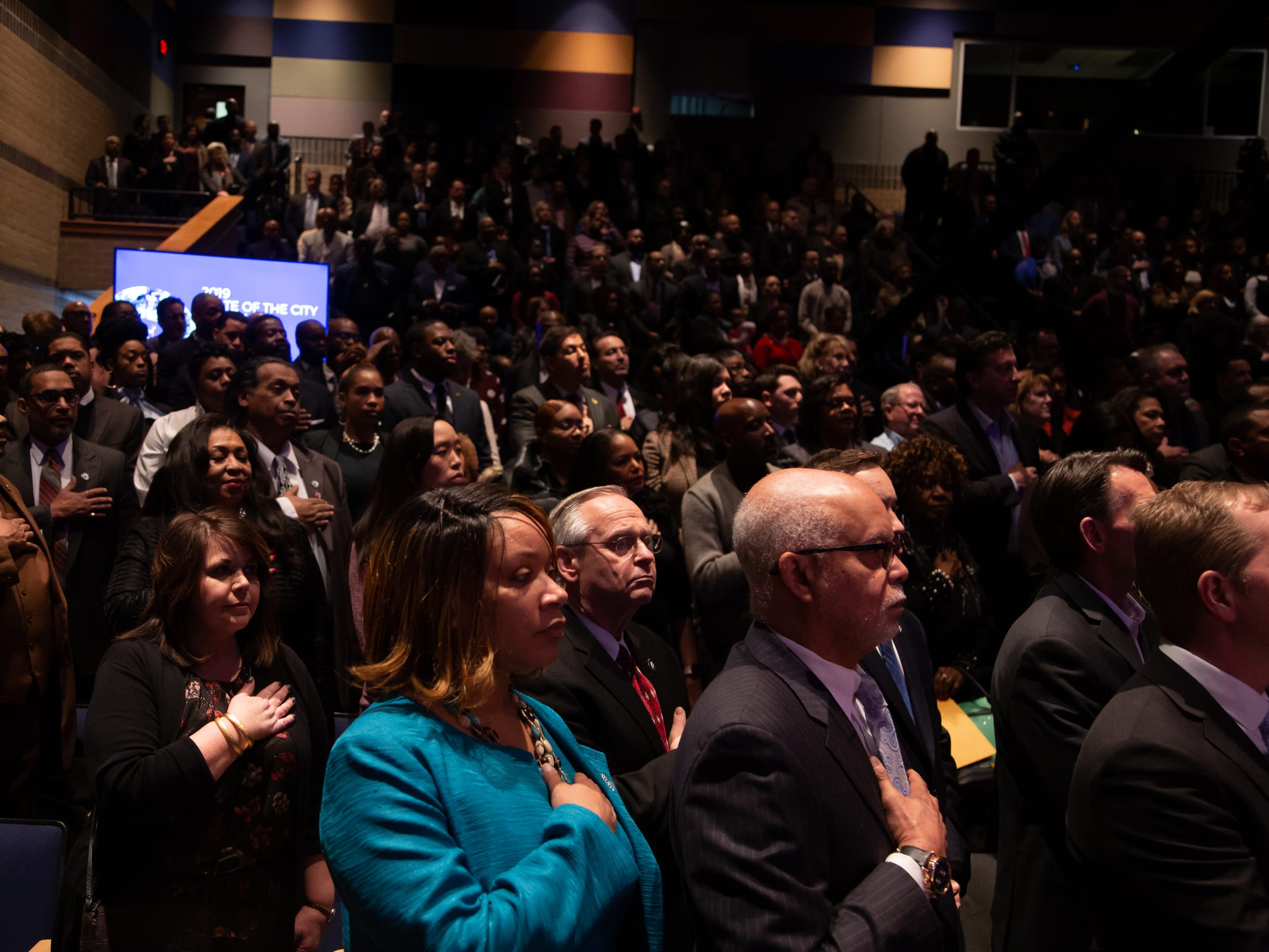 People stand before the start of Detroit Mayor Mike Duggan's speech during the 2019 State of the City Address on Tuesday, March 5, 2019 at East English Village Preparatory Academy in Detroit.
