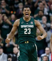 Michigan State forward Xavier Tillman reacts after a basket during the first half of an NCAA college basketball game against Nebraska, Tuesday, March 5, 2019, in East Lansing, Mich.