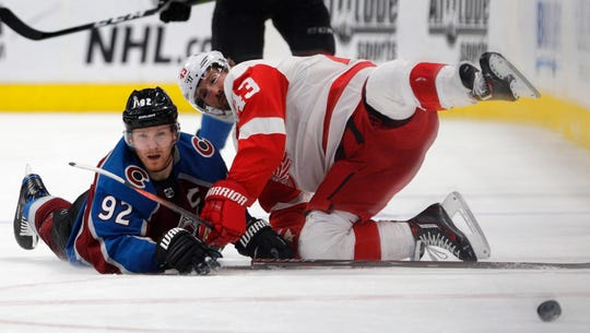 Colorado Avalanche left wing Gabriel Landeskog (92) collides with Detroit Red Wings left wing Darren Helm (43) during the second period of an NHL hockey game in Denver, Tuesday, March 5, 2019.