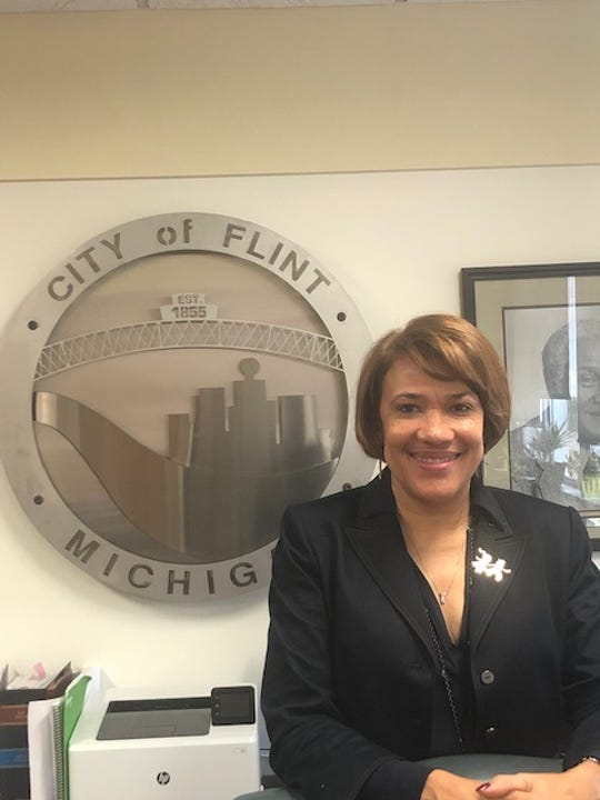 "Flint Mayor Karen Weaver, pictured in her office in 2018, describes Flint as ""strong, resilient and full of pride."""