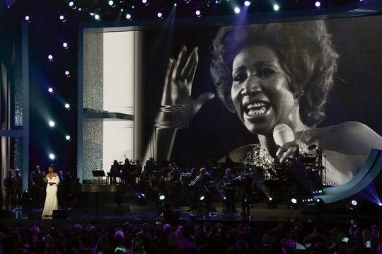 """An image of Aretha Franklin appears on the screen as Jennifer Hudson performs at the """"Aretha! A Grammy Celebration For The Queen Of Soul"""" event at the Shrine Auditorium in Los Angeles on Jan. 13. The special is set to air Sunday on CBS."""