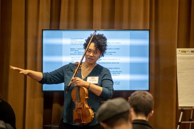 Jessie Montgomery, a composer and violinist, conducts a workshop with the EarShot participants.