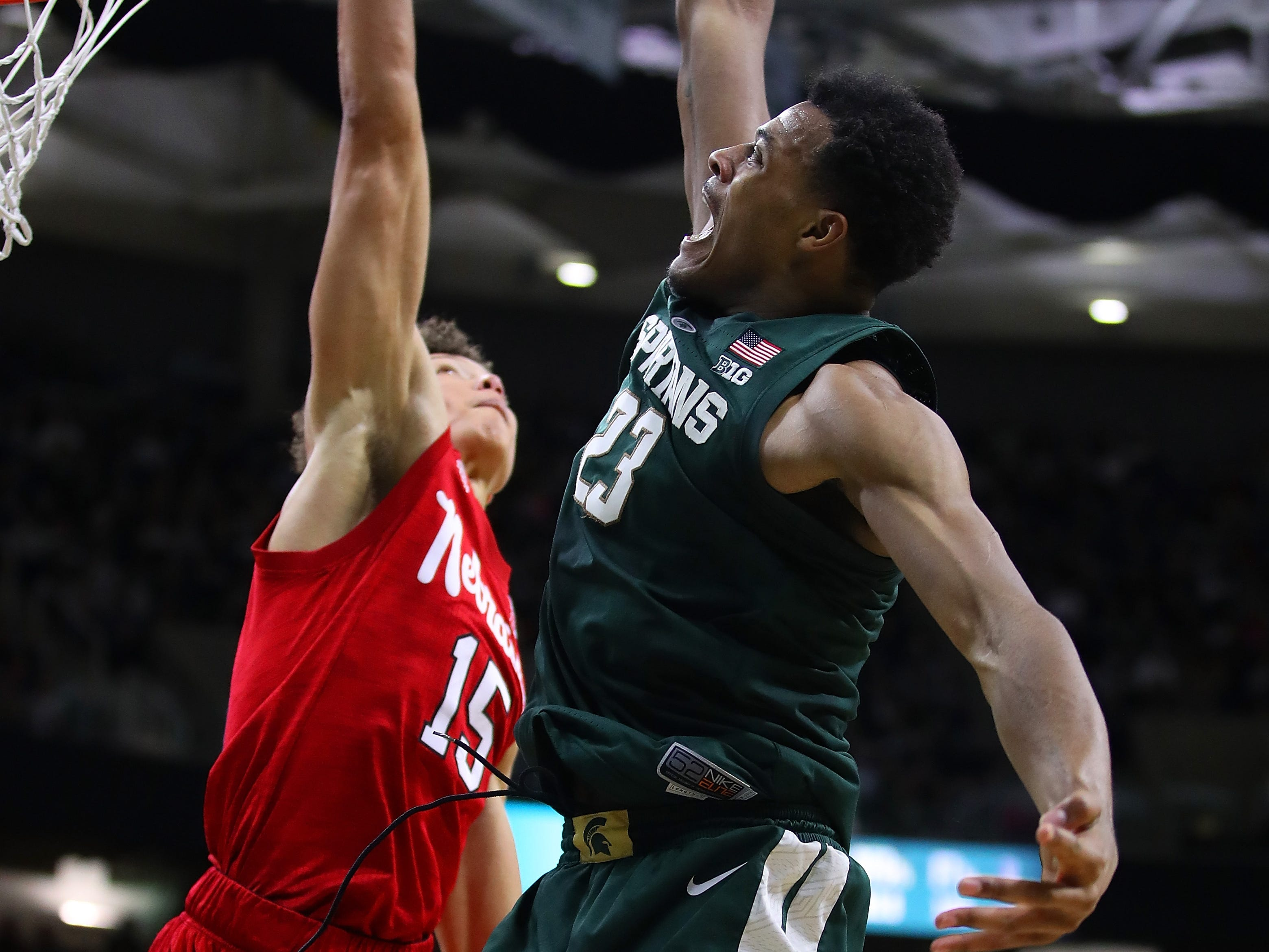 Xavier Tillman (23) of the Michigan State Spartans tries to dunk over Isaiah Roby (15) of the Nebraska Cornhuskers during the first half at Breslin Center on March 05, 2019 in East Lansing, Michigan.
