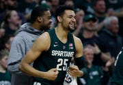 Michigan State forward Kenny Goins' career game of 24 points shared the postgame spotlight with events transpiring in Minneapolis where Minnesota upset No. 11 Purdue.