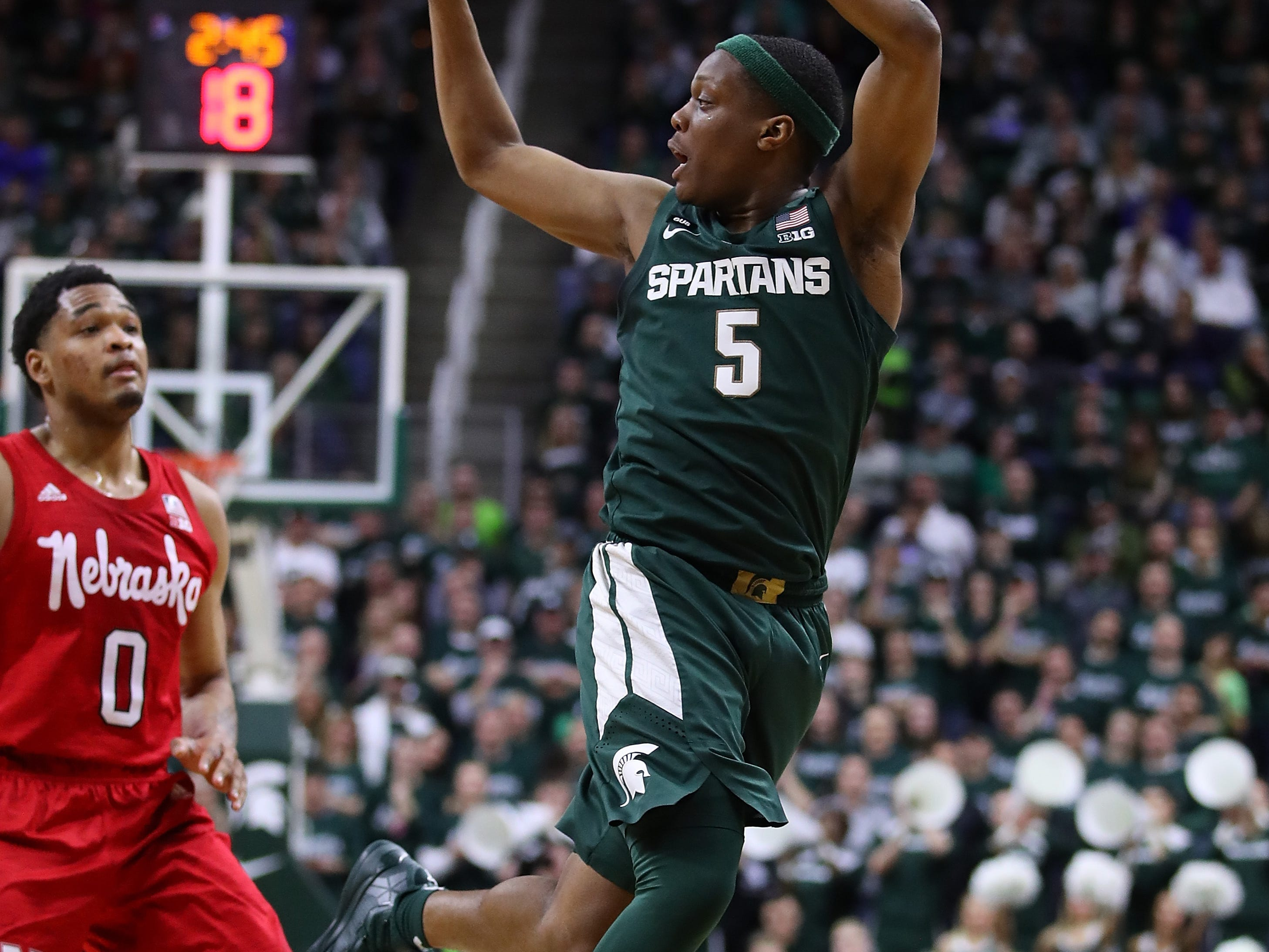 Cassius Winston (5) of the Michigan State Spartans looks to pass in front of James Palmer Jr. (0) of the Nebraska Cornhuskers at Breslin Center on March 05, 2019 in East Lansing, Michigan.