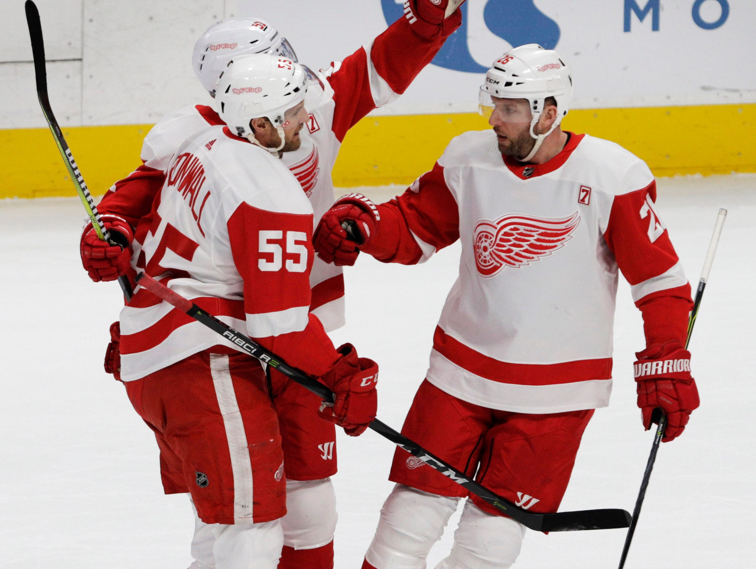 Detroit Red Wings left wing Thomas Vanek (26) congratulates defenseman Niklas Kronwall (55) on his goal during the first period of an NHL hockey game against the Colorado Avalanche in Denver, Tuesday, March 5, 2019.