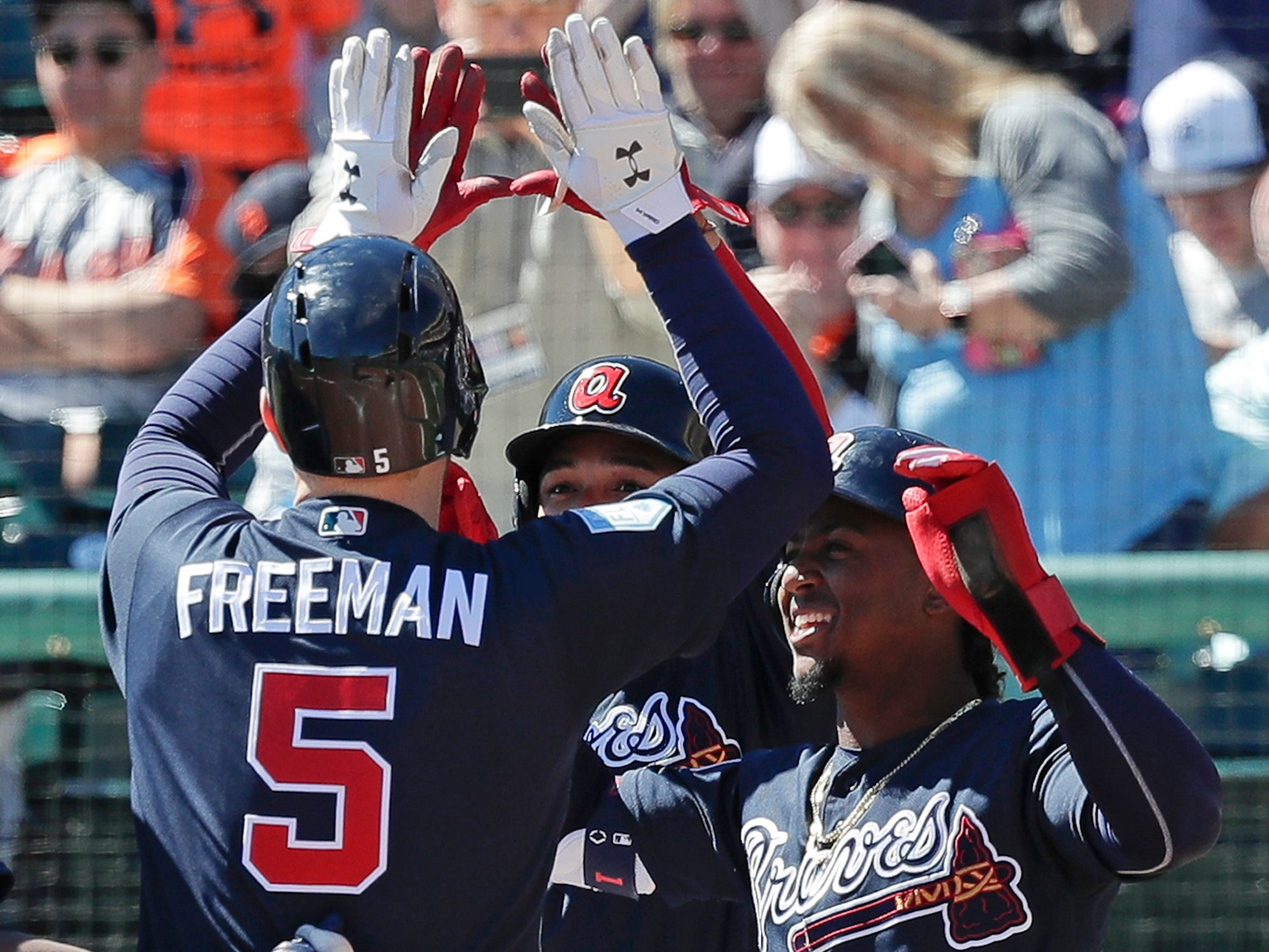 Atlanta Braves' Freddie Freeman (5) celebrates his third inning grand slam home run against the Detroit Tigers with teammates outside the dugout during a spring baseball exhibition game, Wednesday, March 6, 2019, in Kissimmee, Fla.