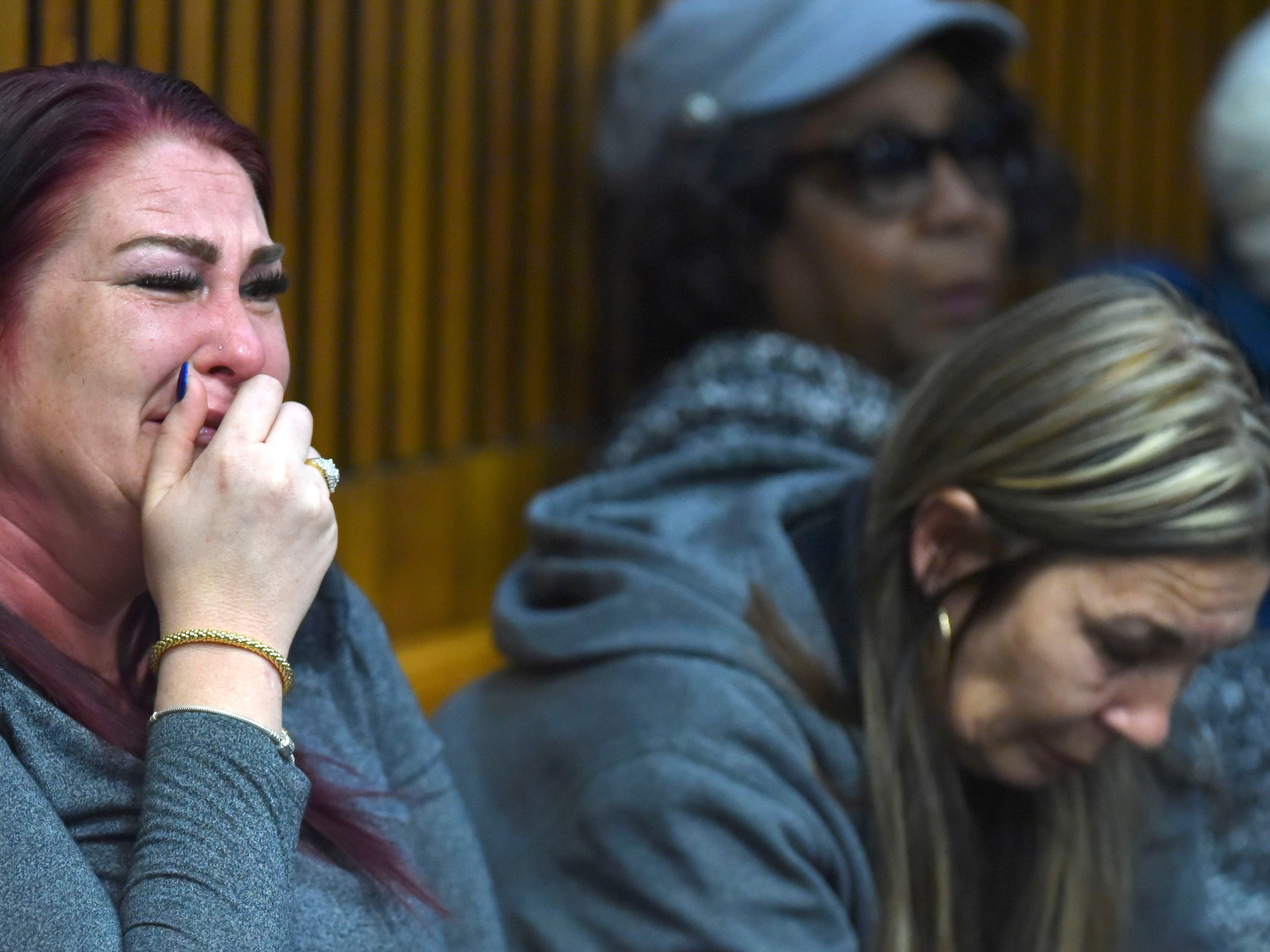 Natalie Brooks, left, wife of murderer Decharlos Brooks, cries while sitting with her mother, Candace Scott, right, as Decharlos is sentenced to 36 to 60 years in prison.