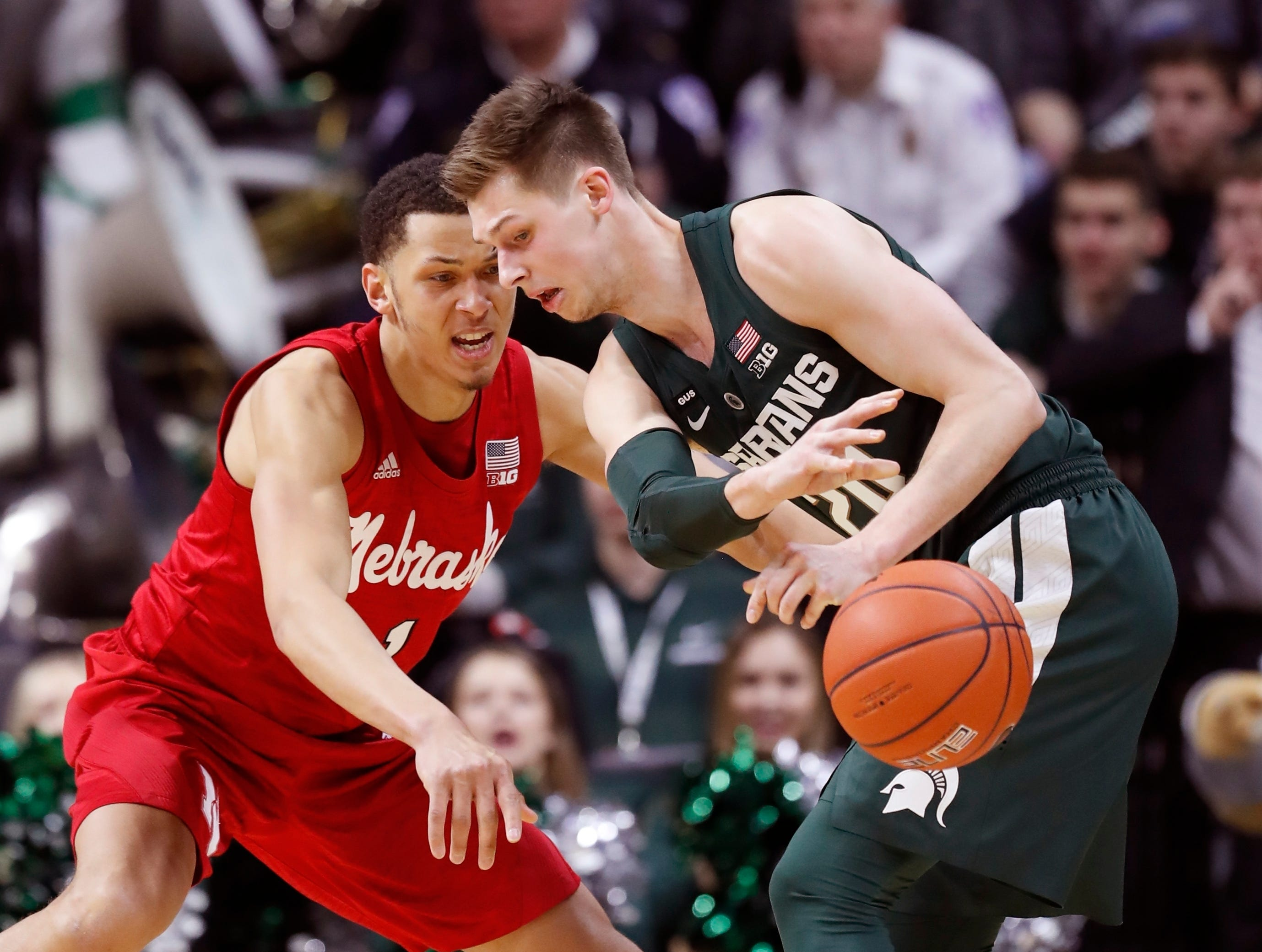 Nebraska guard Amir Harris, left, knocks the ball away from Michigan State guard Matt McQuaid, right, during the first half of an NCAA college basketball game, Tuesday, March 5, 2019, in East Lansing.