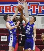 Detroit Catholic Central's Davis Lukomski (left) and Mike Harding (right) help make up arguably one of the tallest starting lineups in the state.