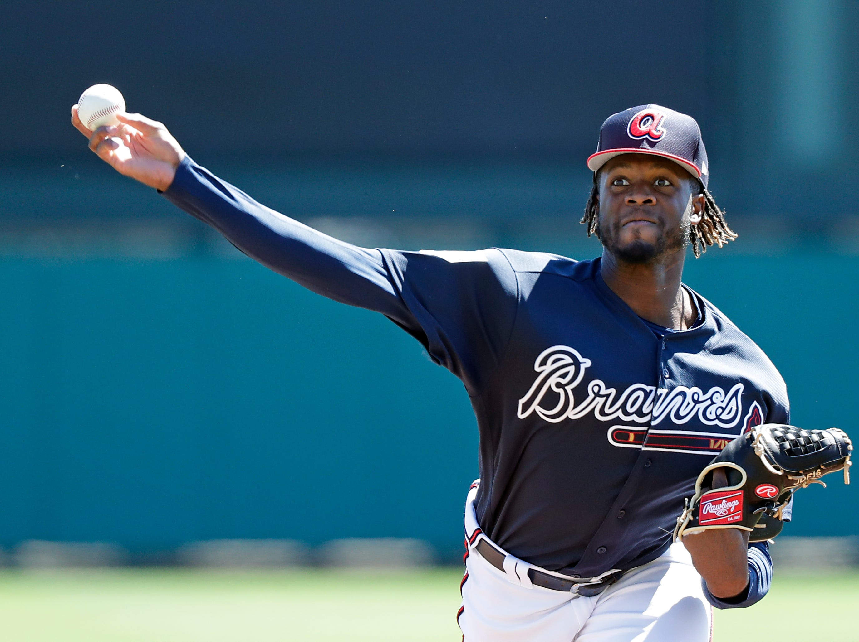 Atlanta Braves' Touki Toussaint pitches against the Detroit Tigers in the first inning of a spring baseball exhibition game, Wednesday, March 6, 2019, in Kissimmee, Fla.