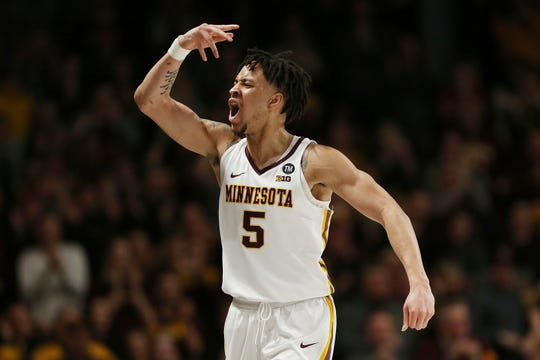 Minnesota's guard Amir Coffey reacts after scoring against Purdue during the second half Tuesday.  Minnesota won 73-69.