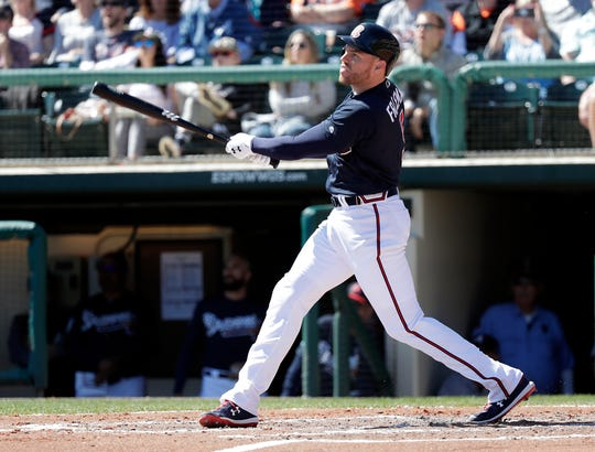 The Atlanta Braves' Freddie Freeman hits a grand slam against the Detroit Tigers in the third inning Wednesday.