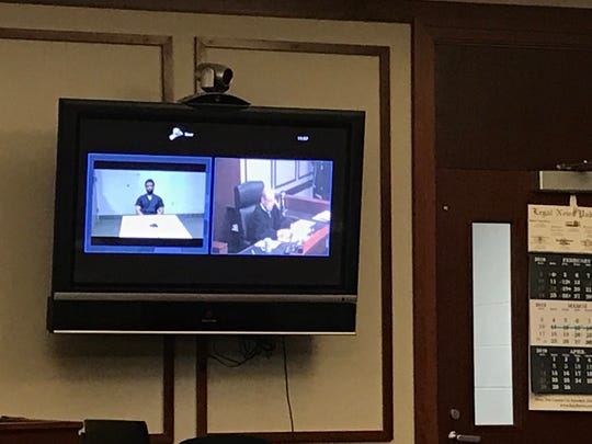 Floyd Galloway enters a not guilty plea during his video arraignment Wednesday in 47th District Court of Farmington Hills.