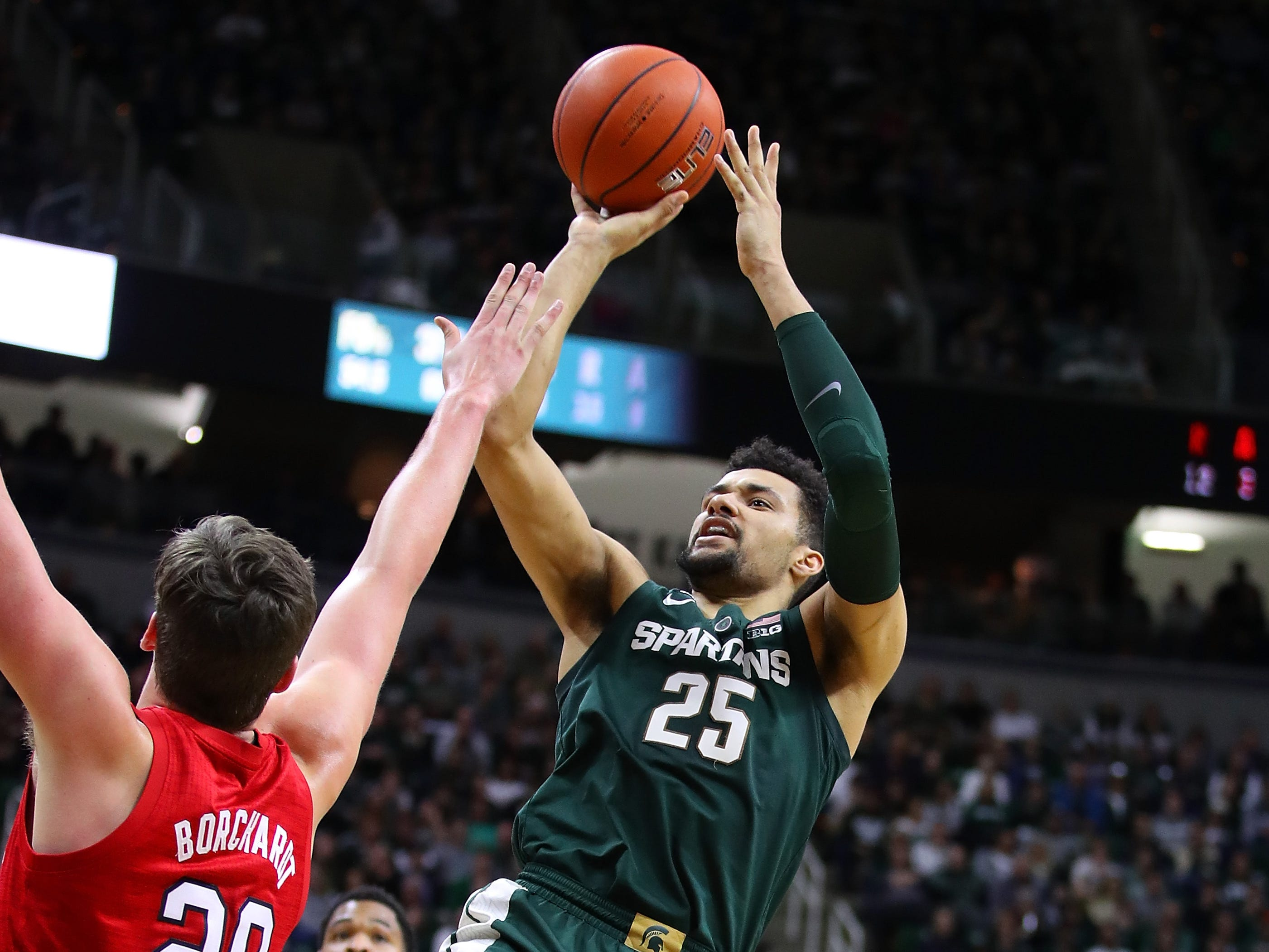 Kenny Goins (25) of the Michigan State Spartans takes a first half shot over Tanner Borchardt (20) of the Nebraska Cornhuskers at Breslin Center on March 05, 2019 in East Lansing, Michigan.