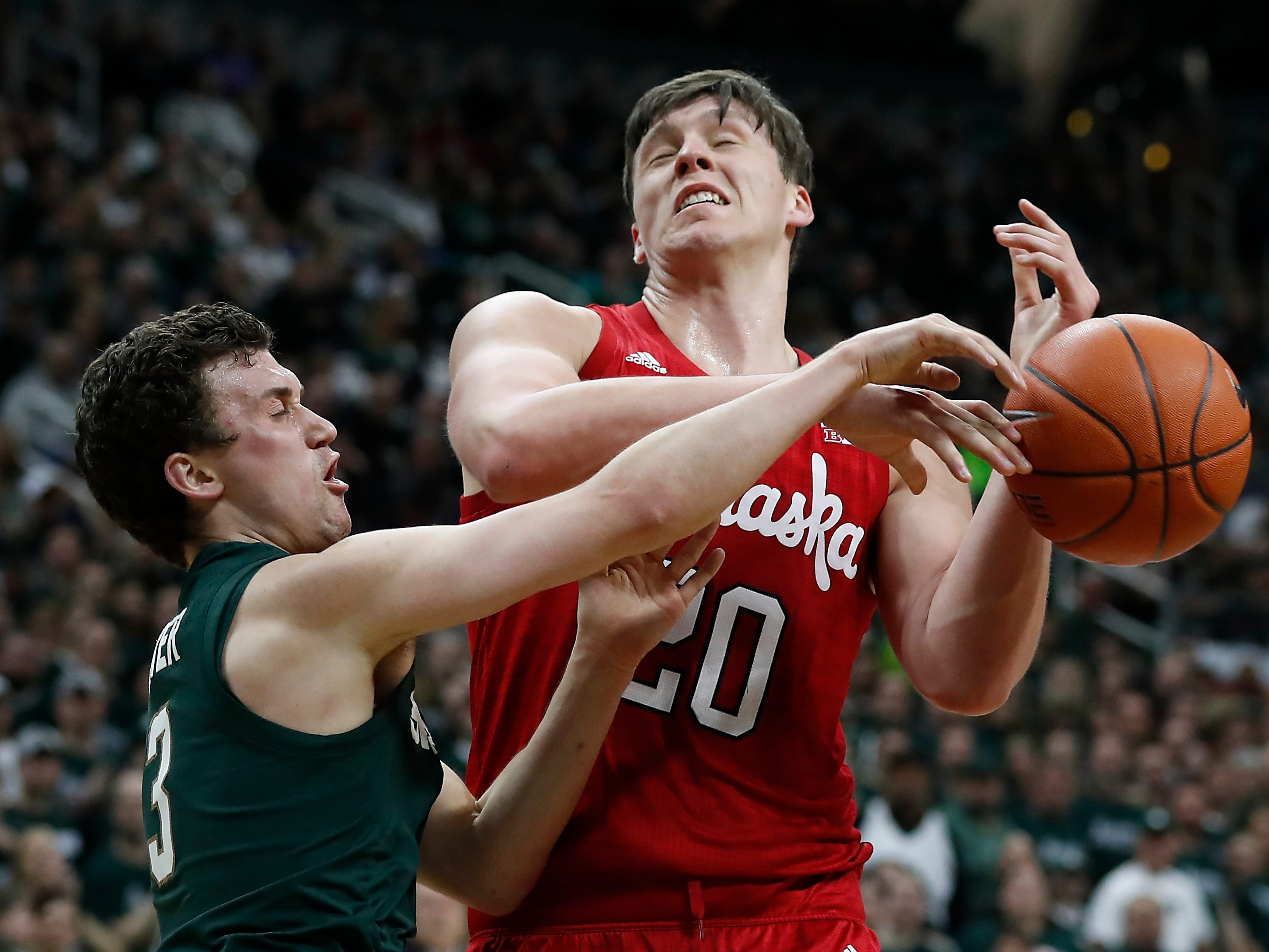 Michigan State guard Foster Loyer, left, knocks the ball away from Nebraska forward Tanner Borchardt, right, during the first half of an NCAA college basketball game, Tuesday, March 5, 2019, in East Lansing, Mich.