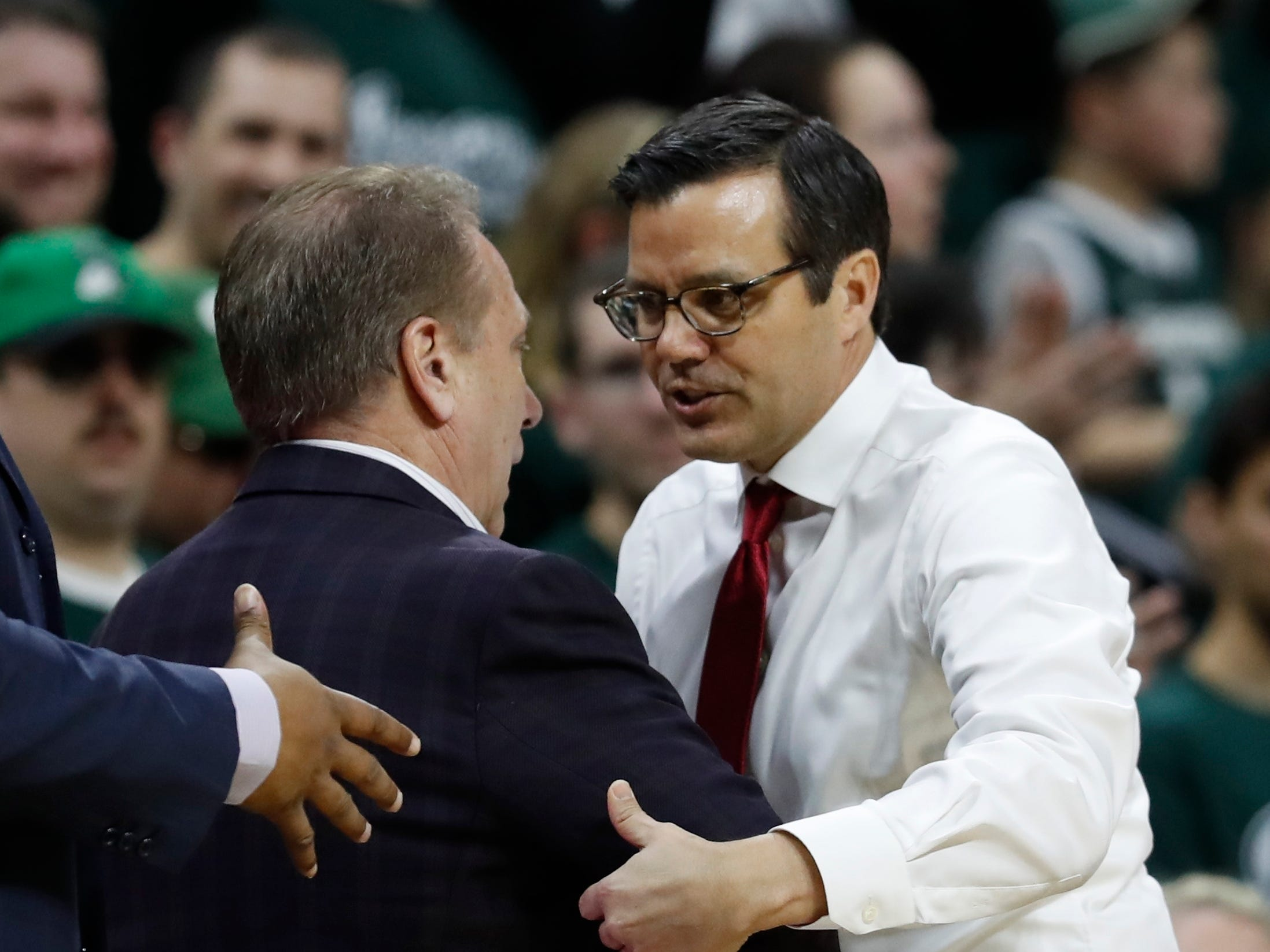 Michigan State head coach Tom Izzo, left, greets Nebraska head coach Tim Miles after an NCAA college basketball game, Tuesday, March 5, 2019, in East Lansing, Mich.
