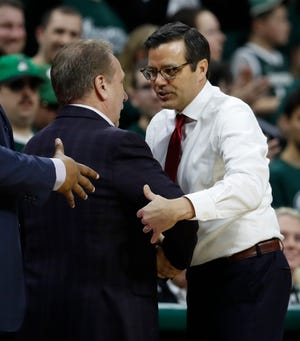 MSU coach Tim Izzo greets Nebraska coach Tim Miles after their game March 5.