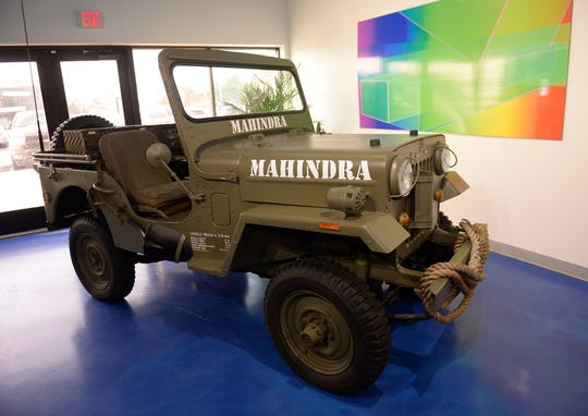 A Mahindra military vehicle is on display in the lobby of the company's Auburn Hills facility.