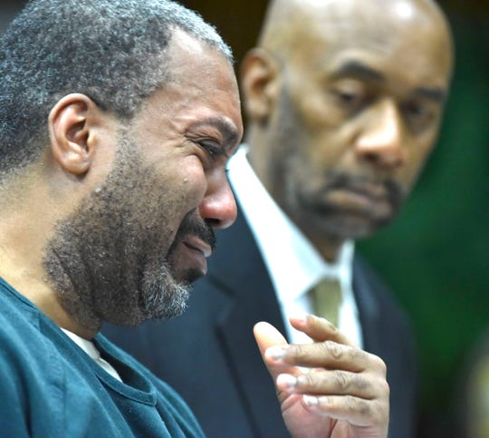 Decharlos Brooks, left, starts to cry while apologizing to the Doss family before he is sentenced, while defense attorney James Anderson, stands beside him. Brooks was  sentenced to 36 to 60 years in a state prison (with 406 days served) for the December 2018 shooting murder of Detroit Police Officer Glenn Doss Jr.