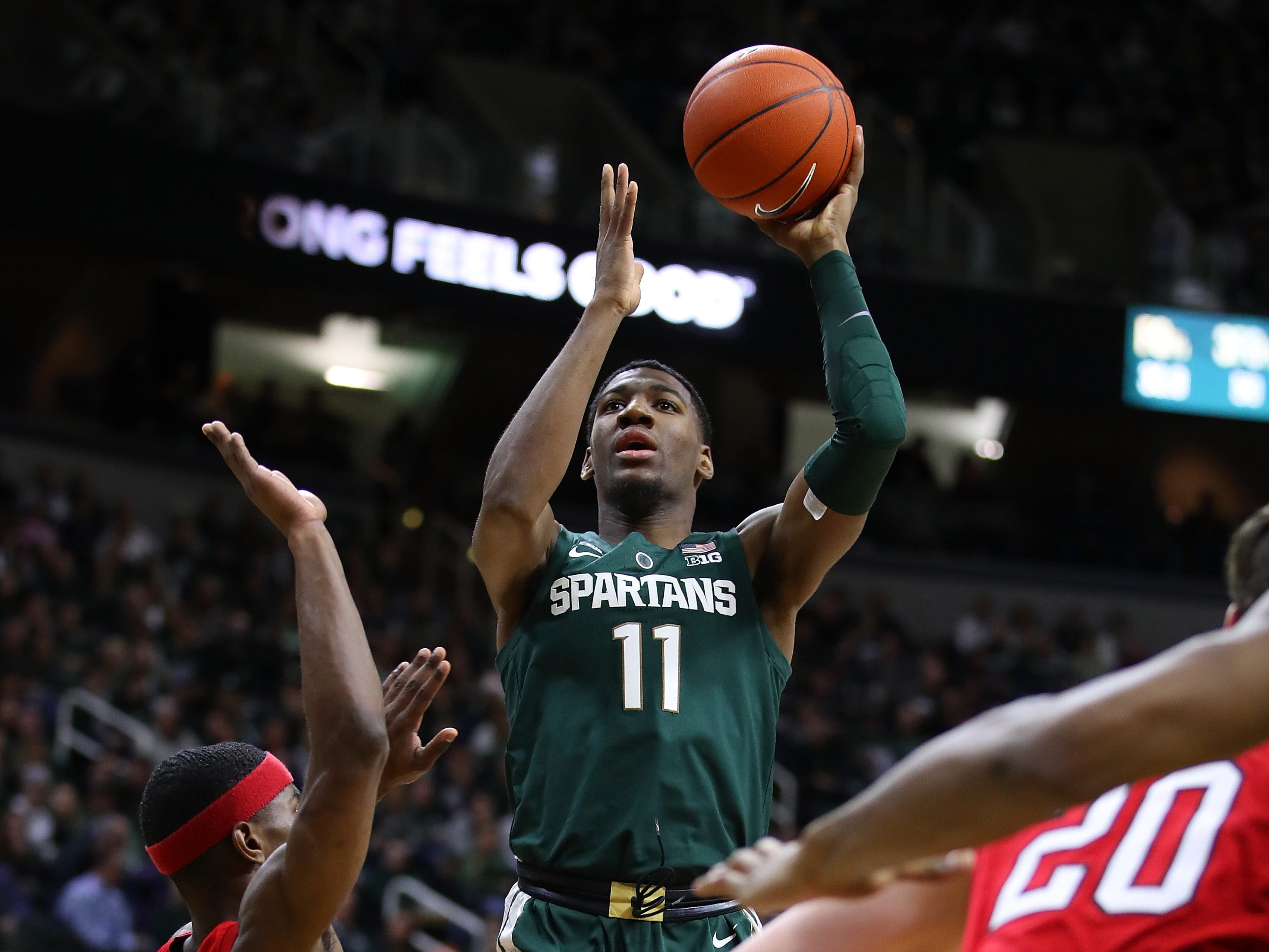 Aaron Henry (1) of the Michigan State Spartans takes a shot over Glynn Watson Jr. (5) of the Nebraska Cornhuskers during the first half at Breslin Center on March 05, 2019 in East Lansing, Michigan.
