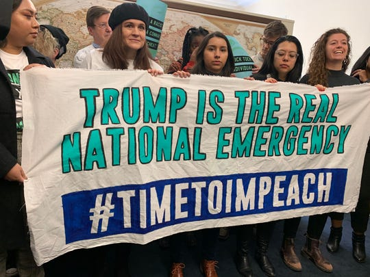 Activists with the group By the People gathered in Rep. Rashida Tlaib's Capitol Hill office on Wednesday for her impeachment announcement.