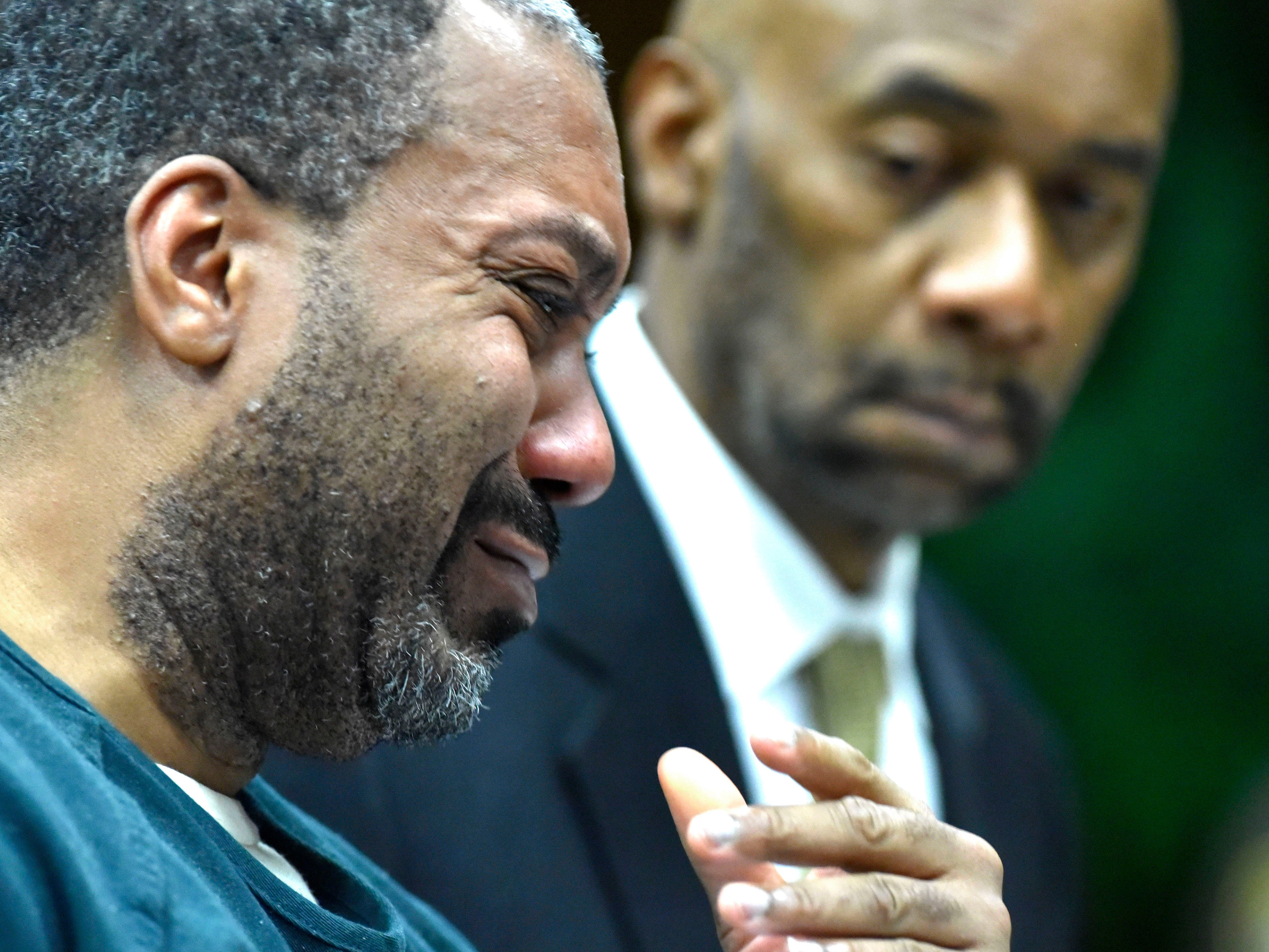 Decharlos Brooks, left, starts to cry while apologizing to the Doss family before he is sentenced.  His defense attorney, James Anderson, stands beside him. He was  sentenced to 36 to 60 years in a state prison (with 406 days served) for the December 2018 shooting murder of Detroit Police Officer Glenn Doss Jr.