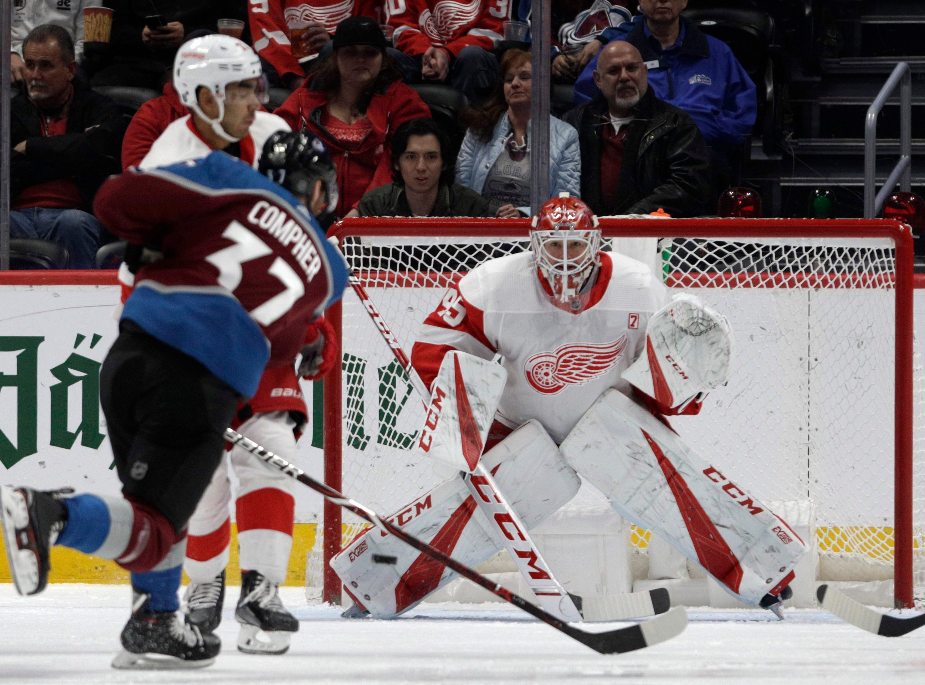 Colorado Avalanche left wing J.T. Compher (37) scores a goal against Detroit Red Wings goaltender Jonathan Bernier (45) during the second period of an NHL hockey game in Denver, Tuesday, March 5, 2019.