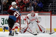 Colorado Avalanche left wing J.T. Compher (37) scores a goal against Detroit Red Wings goaltender Jonathan Bernier (45) during the second period Tuesday. Colorado won 4-3 in overtime, handing Detroit its eighth straight defeat.