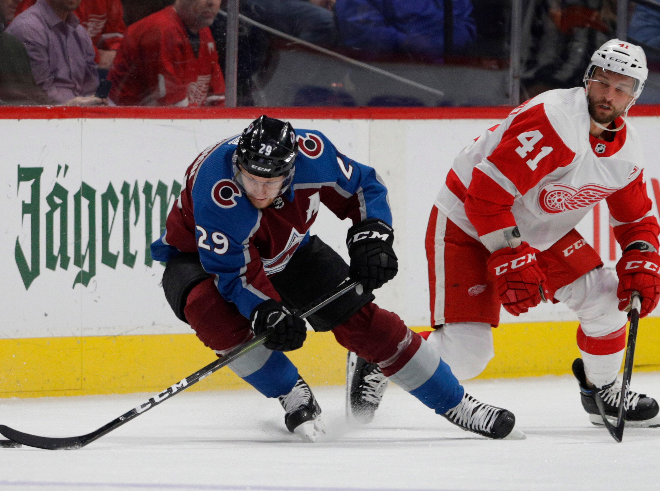 Colorado Avalanche center Nathan MacKinnon (29) skates away from Detroit Red Wings center Luke Glendening (41) during the second period of an NHL hockey game in Denver, Tuesday, March 5, 2019. Colorado won 4-3 in overtime. (AP Photo/Joe Mahoney)