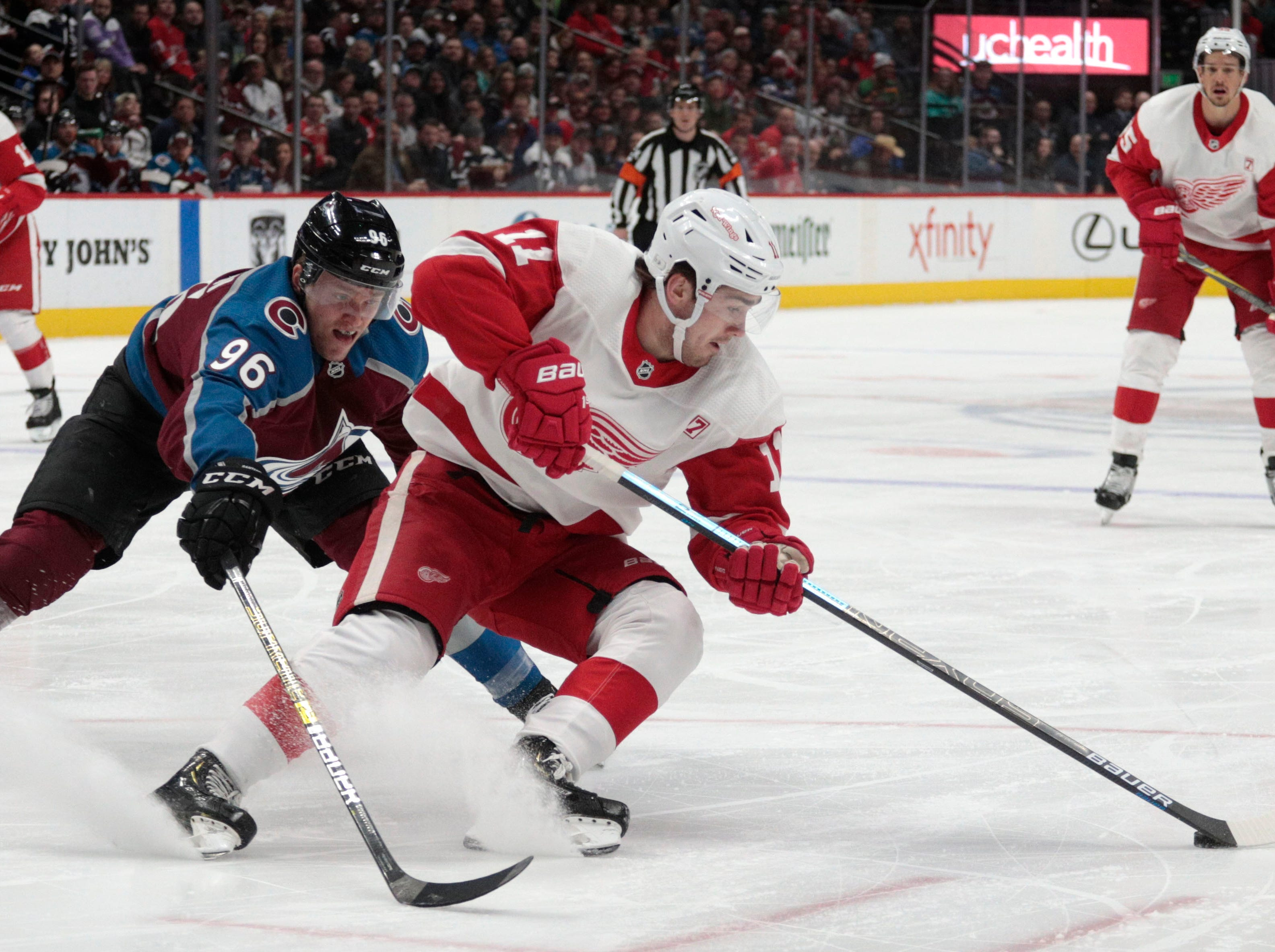 Colorado Avalanche right wing Mikko Rantanen (96) defends against Detroit Red Wings right wing Filip Zadina (11) during the second period of an NHL hockey game in Denver, Tuesday, March 5, 2019.