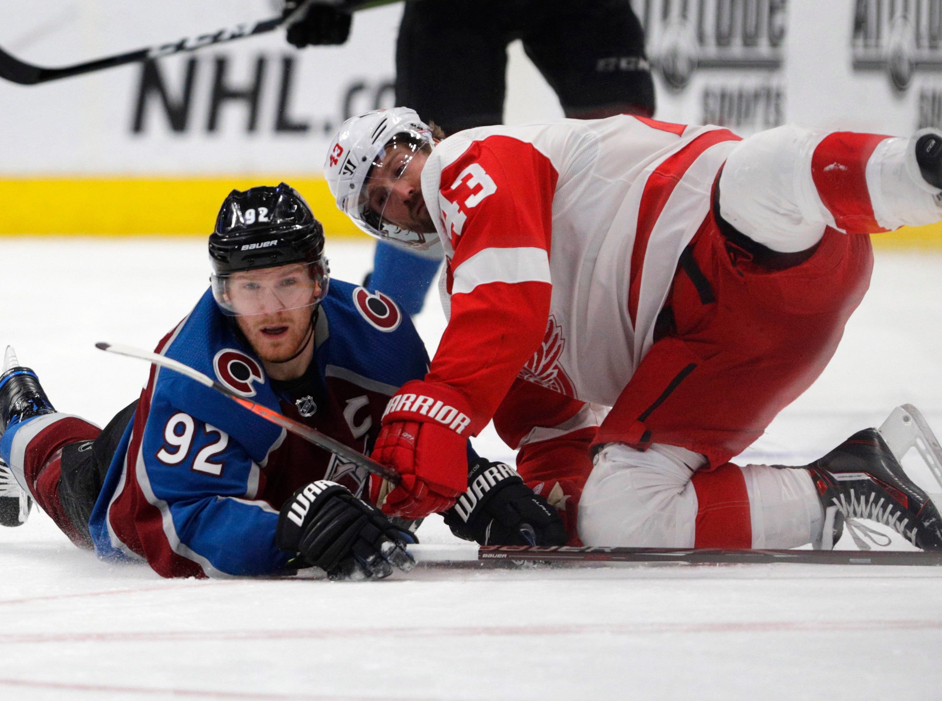 Colorado Avalanche left wing Gabriel Landeskog (92) collides with Detroit Red Wings left wing Darren Helm (43) during the second period of an NHL hockey game in Denver, Tuesday, March 5, 2019