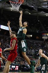 Kenny Goins (25) of the Michigan State Spartans takes a shot over Brady Heiman (45) of the Nebraska Cornhuskers during the first half Tuesday. Goins finished with a career of 24 points in MSU's 91-76 victory.