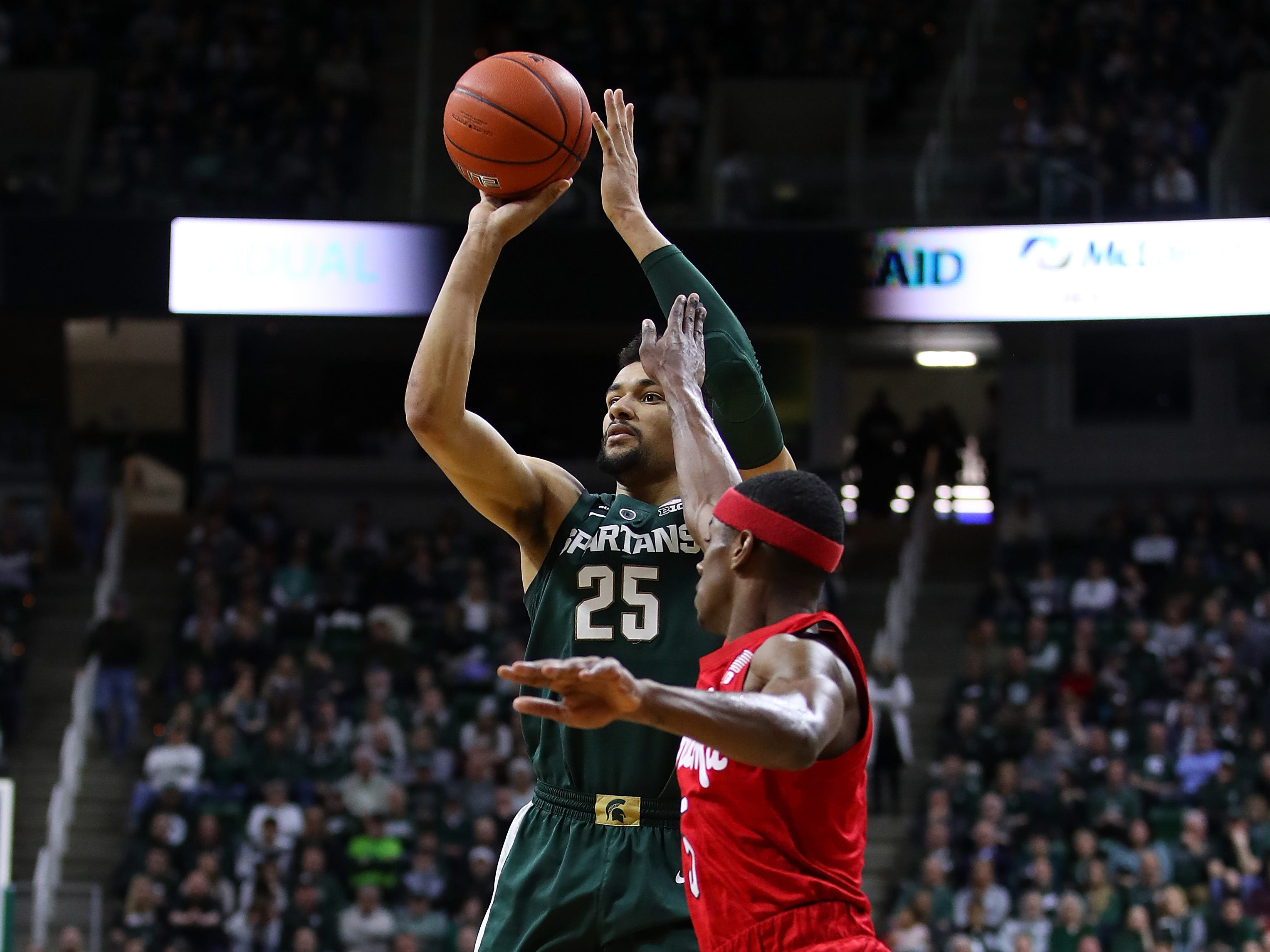 Kenny Goins (25) of the Michigan State Spartans takes a first half shot next to Glynn Watson Jr. (5) of the Nebraska Cornhuskers during the first half at Breslin Center on March 05, 2019.