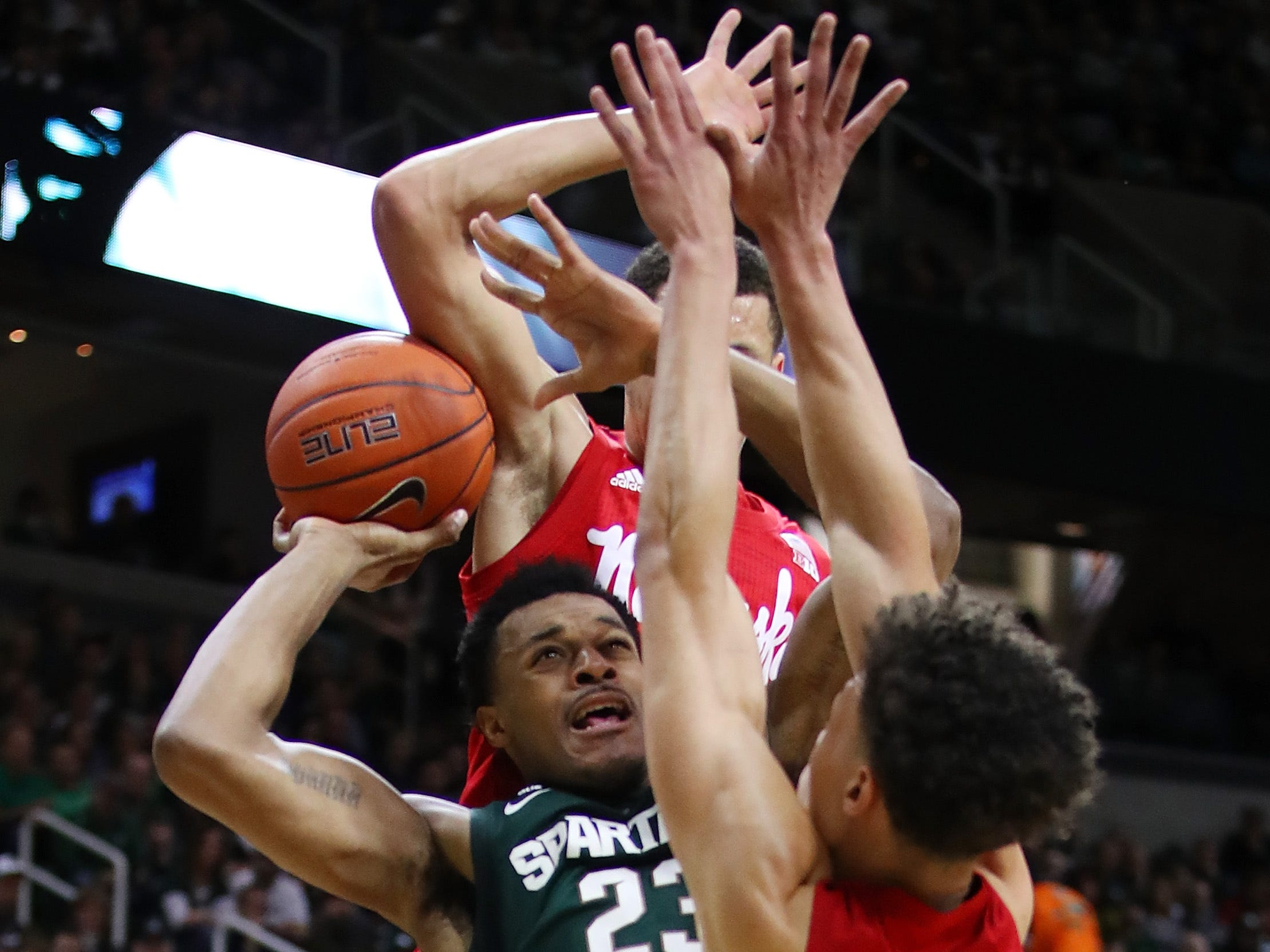 Xavier Tillman (23) of the Michigan State Spartans tries to get a shot off over Isaiah Roby (15) of the Nebraska Cornhuskers during the first half at Breslin Center on March 05, 2019
