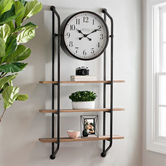 An industrial wall clock has display shelves as an added bonus for accent pieces.